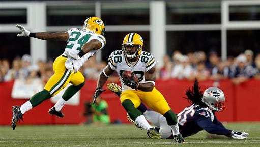 Green Bay Packers wide receiver Ty Montgomery (88) eludes New England Patriots defensive back Jimmy Jean (35) during a punt return in the first half of an NFL preseason football game Thursday, Aug. 13, 2015, in Foxborough, Mass. (AP Photo/Michael Dwyer)