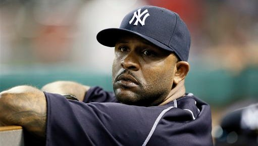 New York Yankees' CC Sabathia stands in the dugout in the eighth inning of a baseball game against the Texas Rangers Monday July 27, 2015, in Arlington, Texas. (AP Photo/Tony Gutierrez)