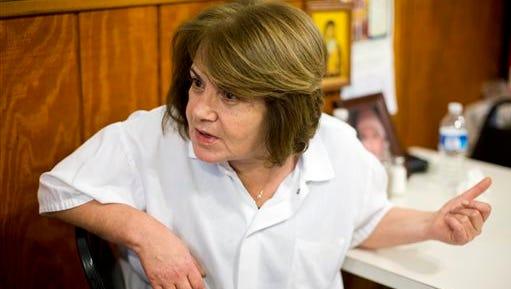 Marie Jarrah, co-owner of the Damascus Restaurant, speaks during an interview Nov. 18 in Allentown.
