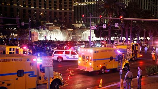 Police and emergency crews respond to the scene of an incident along Las Vegas Boulevard, Sunday, Dec. 20, 2015, in Las Vegas. A woman intentionally swerved her car onto a busy sidewalk two or three times Sunday and mowed down people outside a casino, killing one person and injuring at least 30 others, police said.