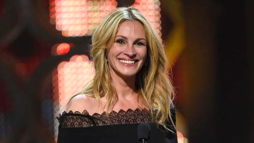 "FILE - In this June 4, 2016, file photo, Julia Roberts accepts the woman of the decade award at the Guys Choice Awards in Culver City, Calif. The Hollywood Reporter said on Dec. 15, 2016, that Roberts would be taking on her first regular TV role in a miniseries adaptation of Maria Semple's novel, ""Today Will Be Different."""