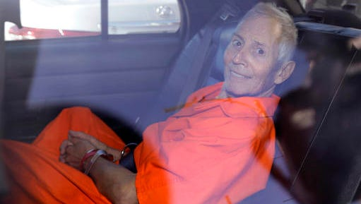 FILE - In March 17, 2015, file photo, New York real estate heir Robert Durst smiles as he is transported from Orleans Parish Criminal District Court to the Orleans Parish Prison after his arraignment on murder charges in New Orleans. Durst, 73, charged with murdering a friend in Los Angeles told a prosecutor he never fled because of inertia. Documents released Friday, Dec. 16, 2016, show Durst told a prosecutor he was the world's worst fugitive. Durst did not confess to the killing but he said he was willing to provide information Deputy District Attorney John Lewin sought in exchange for a better prison assignment.