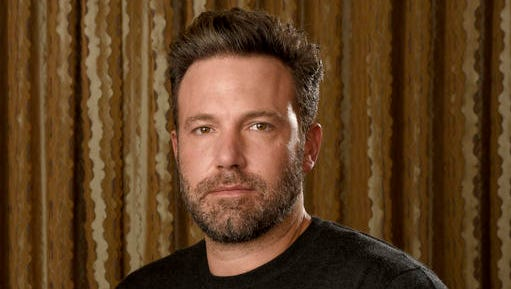 "FILE - In this Sept. 30, 2016 photo, Ben Affleck poses at The Four Seasons Hotel in Los Angeles. Affleck is hoping to flip the script again. In between ""Batman"" movies, he's releasing his directorial follow-up to his Oscar-winning ""Argo"": ""Live By Night,"" adapted from Dennis Lehane's crime novel about a Prohibition era-gangster who decamps from Boston to Ybor City, Florida, to create a rum-running empire.  (Photo by Chris Pizzello/Invision/AP, File)"