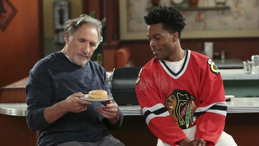 """This image released by CBS shows Judd Hirsch, left, and Jermaine Fowler in a scene from the new comedy series, """"Superior Donuts,"""" premiering  Thursday, Feb. 2, on CBS."""