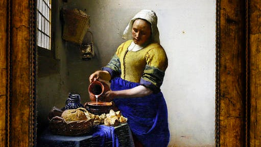 "Detail of ""The Milkmaid"", a 1658-1659 oil painting on canvas by Johannes Vermeer presented to the press during the opening of the exhibition entitled ""Vermeer and the Masters of Genre Painting,"" at Louvre Museum, in Paris, Tuesday, Feb. 21, 2017. The Louvre has inaugurated a major exhibit of old master Johannes Vermeer, presenting 12 of the Flemish painter's oil canvasses including The Milkmaid."