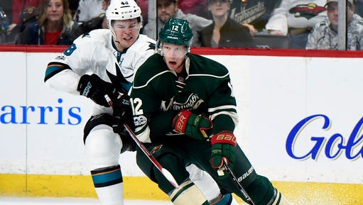 Minnesota Wild center Eric Staal (12) controls the puck against San Jose Sharks center Tomas Hertl (48), of the Czech Republic, during the second period of an NHL hockey game, Sunday, March 5, in St. Paul.