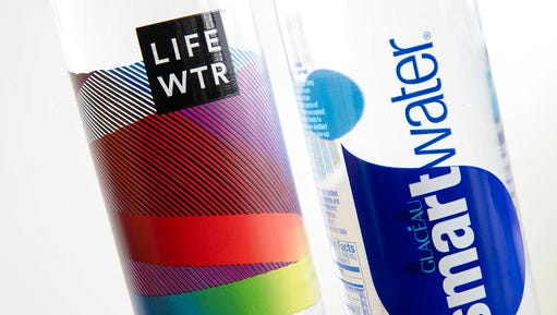 """In this Thursday, March 16, 2017, photo, bottles of Lifewtr and Smartwater are displayed in Philadelphia. As bottled water surges in popularity, Coke, Pepsi and other companies are using celebrity endorsements, stylish packaging and fancy filtration processes like """"reverse osmosis"""" to sell people on expanding variations of what comes out of the tap. They're also adding flourishes like bubbles, flavors or sweeteners that can blur the lines between what is water and what is soda."""