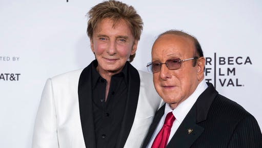 """Barry Manilow, left, and Clive Davis attend the world premiere of """"Clive Davis: The Soundtrack of Our Lives"""" at Radio City Music Hall, during the 2017 Tribeca Film Festival, Wednesday, April 19, 2017, in New York."""