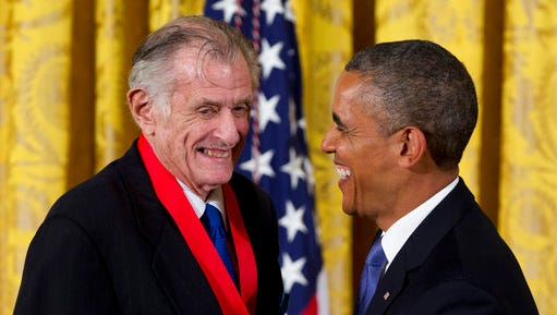 """FILE - In this July 10, 2013, file photo, President Barack Obama laughs with Frank Deford as he awards him the 2012 National Humanities Medal during a ceremony in the East Room of White House in Washington. Deford gave his final sports commentary on NPR's """"Morning Edition"""" Wednesday, ending a run of what he calls """"little homilies"""" that began in 1980."""