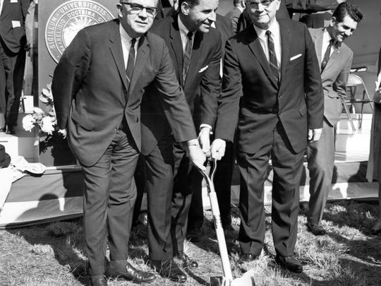 Roy E. Gillespie, Ohio University Zanesville director; Edward M. Penson, vice president of academic services; and Ellis Miracle participate in the OUZ groundbreaking Oct. 19, 1965.