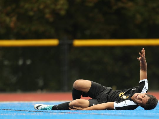 Damien Parker, of Bergen County Tech is shown just after crashing into Passaic County Technical Institute goalie, Angel Sanchez (not shown).  It is believed Parker suffered a broken leg.  The game was continued after a 40 minute game delay, as paramedics were called to help Parker off the field.  Tuesday, September 19, 2017