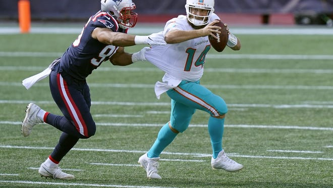 New England defensive end Derek Rivers chases Miami quarterback Ryan Fitzpatrick in the second half of Sunday's game.
