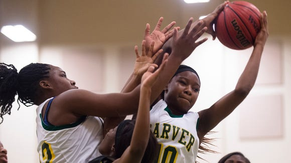 Carver's Shaonica Thomas (10) grabs a rebound during the basketball game on Friday, Feb. 12, 2016, in Montgomery, Ala.