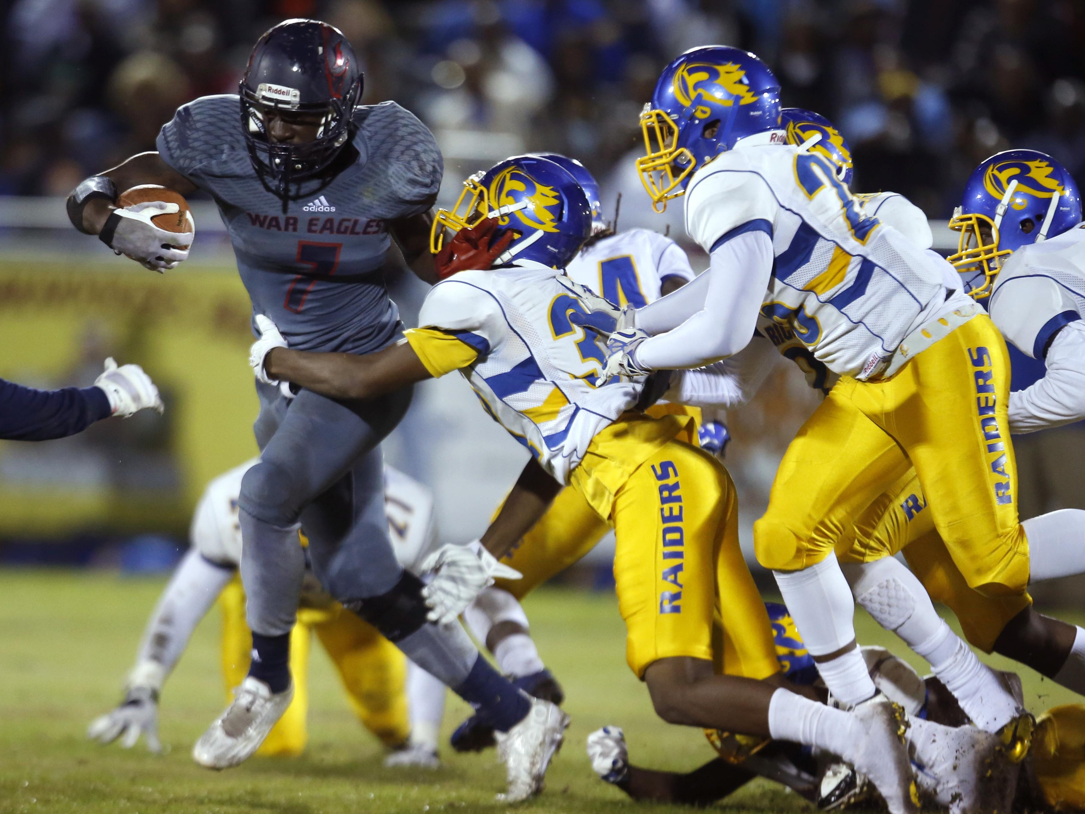 Wakulla's Keith Gavin breaks away from a multitude of Rickards defenders during a punt return for a touchdown in their playoff game two weeks ago.