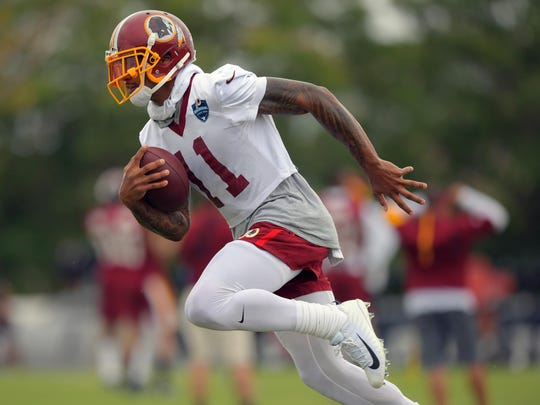 Washington wide receiver Terrelle Pryor works through a drill at the Redskins' training camp in Richmond, Va., on Friday. Must credit: Washington Post photo by John McDonnell