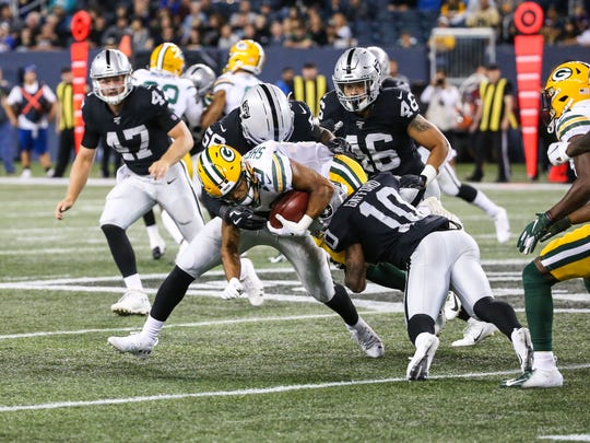 Aug 22, 2019; Winnipeg, Manitoba, CAN; Oakland Raiders wide receiver Rico Gafford (10) tackles Green Bay Packers wide receiver Darrius Shepherd (10) during the fourth quarter at Investors Group Field. Mandatory Credit: Terrence Lee-USA TODAY Sports