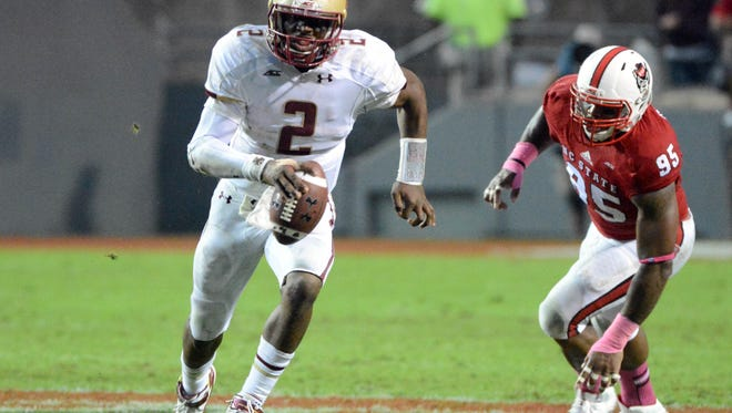 Oct 11, 2014; Raleigh, NC, USA; Boston College Eagles quarterback Tyler Murphy (2) runs the ball during the second half against the North Carolina State Wolfpack at Carter Finley Stadium. Boston College won 30-14. Mandatory Credit: Rob Kinnan-USA TODAY Sports