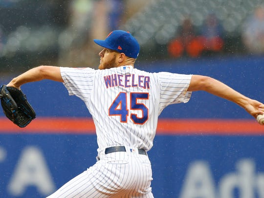 New York Mets starting pitcher Zack Wheeler (45) delivers a pitch in the first inning against Toronto Blue Jays at Citi Field.