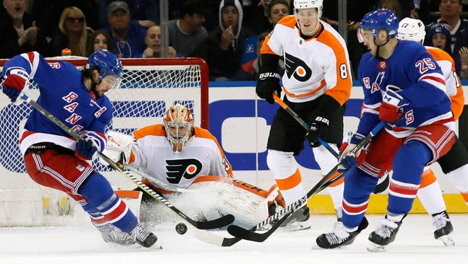 Flyers goalie Michal Neuvirth was injured in the first period on Mats Zuccarello's goal.