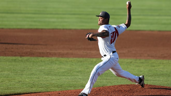 Salem-Keizer's Rayan Hernandez pitches against the Boise Hawks during a game on Tuesday, July 19, 2016, at Volcanoes Stadium in Keizer.