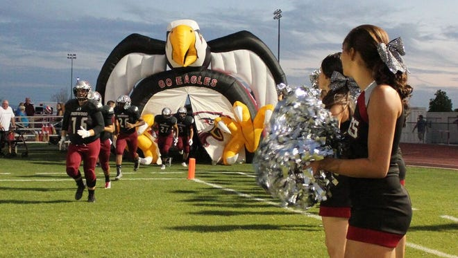 The Glendale Ironwood football team makes its entrance before a game this season.