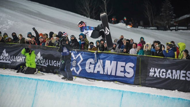 Elena Hight earns the gold in the women's snowboard superpipe final during the Winter X Games on Saturday.
