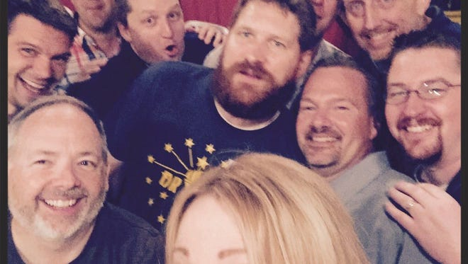 """Scott Swingle, right, in glasses, poses with other """"bros"""" at one of the group's meetups, dubbed """"Brofest,"""" last year. From bottom, clockwise up, the bros in this photo are: @RealLauraSteele, @KennyEarlz, @CantankerousCMF, @dwilly04, @HaverOfOpinions, @GiantAKS, @tokenwhitedude, @wanninger, @JimmyGoetz, @thatdickscott."""