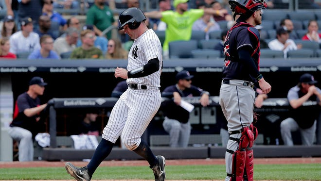 New York Yankees' Austin Romine scores on a sacrifice fly by Brett Gardner against the Cleveland Indians during the fifth inning of a baseball game, Saturday, May 5, 2018, in New York.