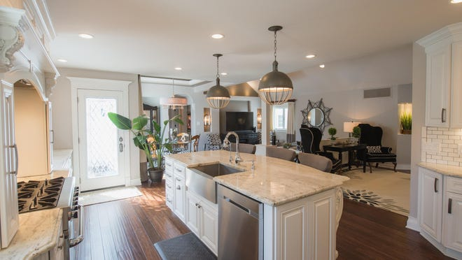 The kitchen opens to the family room and dining area.