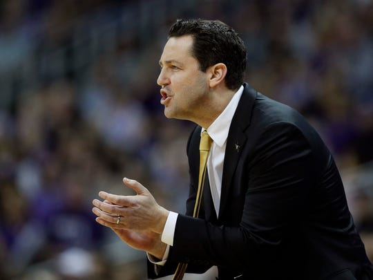 Vanderbilt head coach Bryce Drew talks to his players during the first half against Kansas State Saturday.