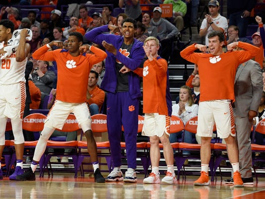 Clemson's Donte Grantham, center, and teammates react on the bench during the second half of an NCAA college basketball game against North Carolina on Tuesday, Jan. 30, 2018, in Clemson, S.C. Clemson won 82-78. (AP Photo/Richard Shiro)