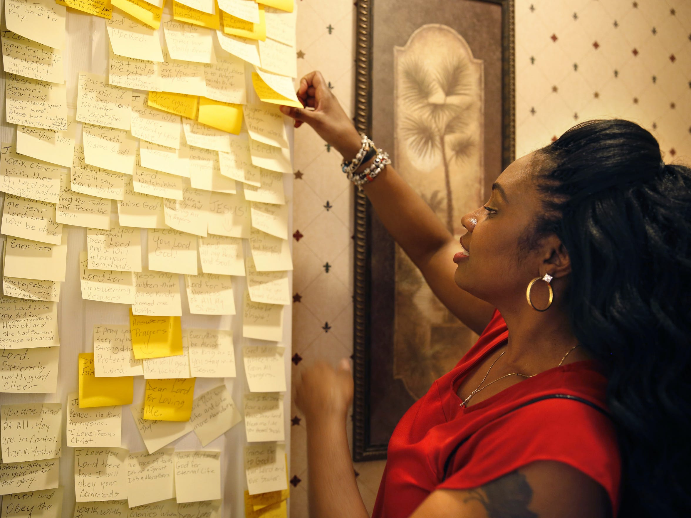 "Lorraine Nichols shows off her ""prayer room"" Dec 11. The post-it notes lining the door of her bathroom closet reflect Nichols' prayers for a baby and her joy at welcoming Caleb Charlie into her life."