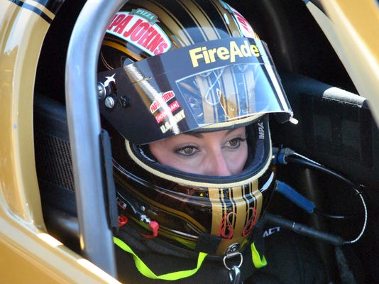 Driver Leah Pritchett waits in her dragster before making a pass at the NHRA Gatornationals at Gainesville Raceway, Saturday, March 17, 2018, in Gainesville, Fla. Pritchett is pulling triple-duty at Gainesville Raceway by competing in her normal Top Fuel class as well as the Factory Stock Showdown and the Papa John's Charity Challenge. (AP Photo/Mark Long)