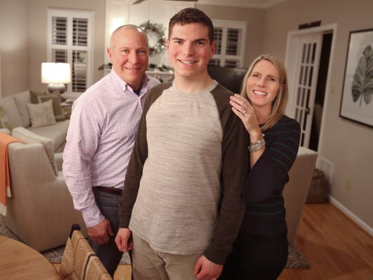 Kevin Fortunato and his parents, John and Cheryl, at