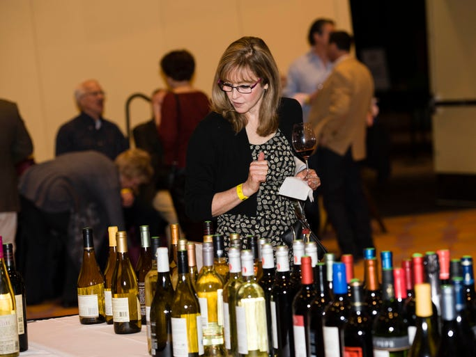 The Cincinnati International Wine Festival brought more than 700 wines for the tasting to Duke Energy Convention Center. Barbara Lancor of Mt. Adams looks at the variety of California Reds at the Silent Auction table.
