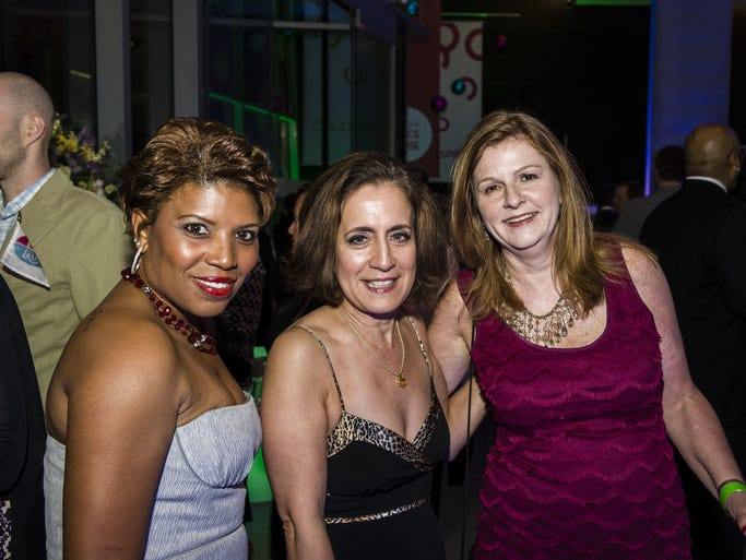 The Contemporary Arts Center celebrated its 75th anniversary with dinner, a live auction and afterparty. Sonya Whaley of Mt. Carmel, Marina Abanto of Anderson and Julie Metz of Clifton.