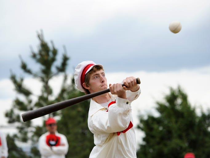 A member of the Bee Farm swings at the ball during the vintage baseball game in the field behind the Bee Family Centennial Farm Museum Saturday, June 14, 2014, in Fort Collins, CO.