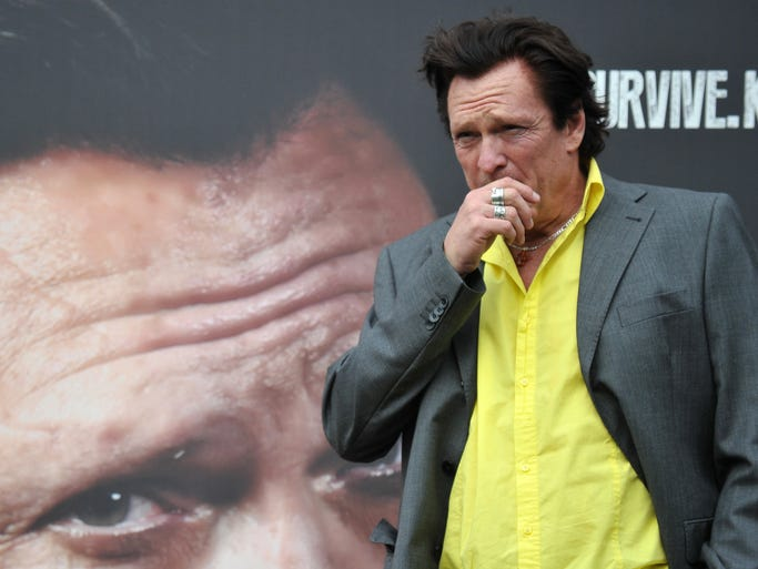 "US actor Michael Madsen poses during the photocall of the movie ""Sights of Death"" directed by Italian Alessandro Capone on January 23, 2014 in Rome.  AFP PHOTO / TIZIANA FABI        (Photo credit should read TIZIANA FABI/AFP/Getty Images)"