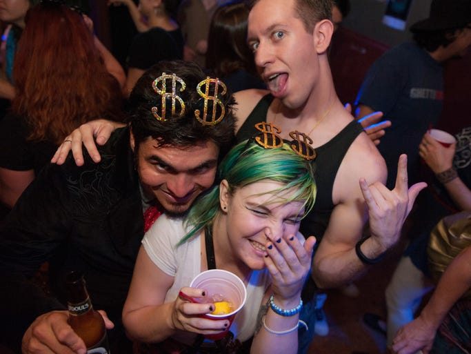 Some friends goof off on the dance floor during Tongue Tied's Old School Jams party at Apollo's Lounge on Saturday, Aug. 2, 2014.