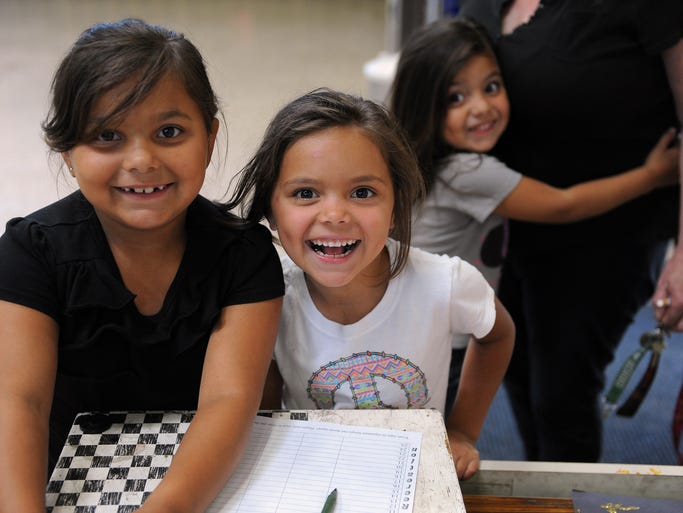 From left, Elvira, 7, Jessica, 6, and Stormy Ferrel, 4, sign in at the El Dorado Park Recreation Center for a four-hour City of Salinas Parks and Community Services program in which they can use the play facilities under gentle supervision. The center has toys, games, art supplies and sports equipment, and offers free lunch and snacks daily through August 8th. Similar comprehensive summer programs are offered by the city at the Breadbox, Central and Firehouse Recreation Centers, as well as the Hebbron Family Center in Salinas. For more information, visit the Parks and Community Services section of the city's web site at http://www.ci.salinas.ca.us/services/recreation/programs.cfm