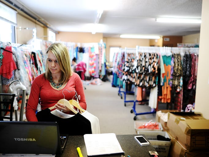 Laura Benson, owner of Filly Flair, works on restocking returned items on Thursday, March 27, 2014, at the Filly Flair warehouse in Colton, S.D. (Joe Ahlquist / Argus Leader)