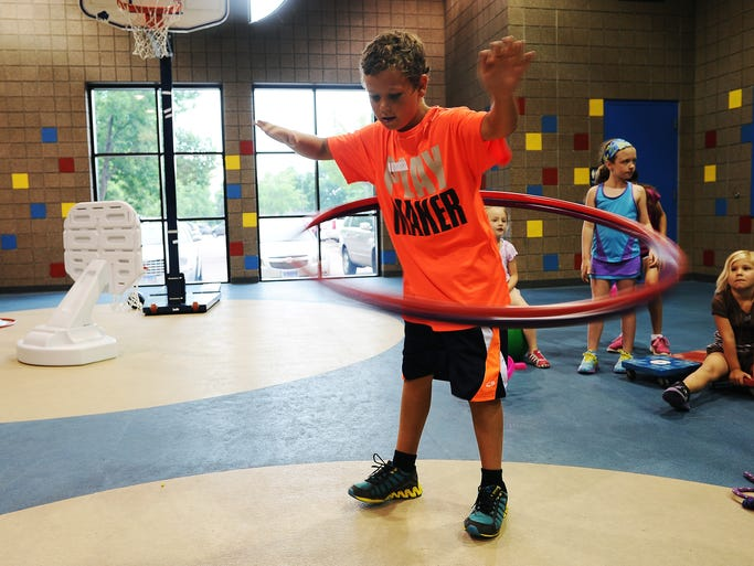 Nate Babb, 9, plays with some hula hoops during Kids Fit 'N' Fun on Thursday, June 26, 2014, at the Sanford Wellness Center in Sioux Falls, S.D. Kids Fit 'N' Fun is a program that aims to get kids to have fun while exercising, said instructor, Colleen McGraw. The program is held from 9:15 a.m. to 10 a.m. on Mondays through Saturdays.