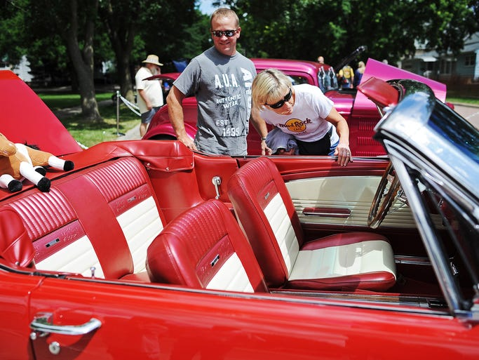 Steve and Anne Lias, of Humboldt, S.D., take a look at the interior of a 1966 Ford Mustang GT on display during the Canton Area Car Show on Sunday, July 27, 2014, in Canton, S.D. Mark Iverson, president of the Lincoln County Cruisers, which runs the car show, said that more than 300 cars, old and new, participated in the show, and estimated between 3,000 and 5,000 people were in attendance.