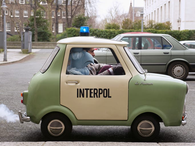 """Ty Burrell and Sam the Eagle take their mini-mini on the road in """"Muppets Most Wanted."""""""
