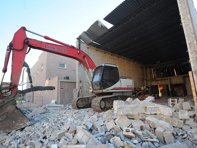 Demolition equipment sits on a pile of rubble that was once the Retlaw Theater in downtown Fond du Lac on Tuesday September 2, 2014.