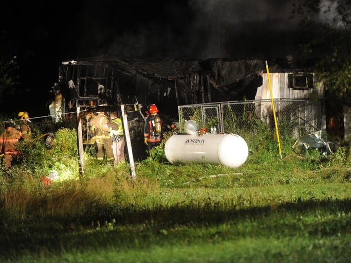 An early morning fire destroyed a mobile home and injured three early Thursday, July 10, 2014.