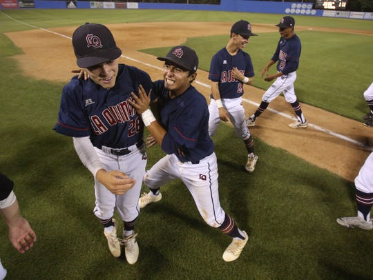 La Quinta celebrate their 6-5 win over Monrovia for