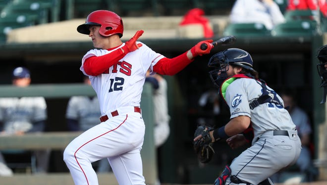 The Louisville Bats' Nick Senzel (12) connected with a pitch during their game against the Columbus Clippers at Slugger Field.  He is one of baseball's top prospects.     April 11, 2018