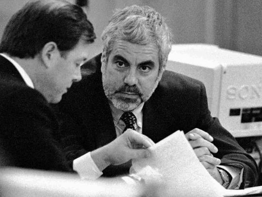 Martin Greenstein, right, a former partner in the law