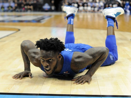 Middle Tennessee State's  JaCorey Williams (22) stumbles